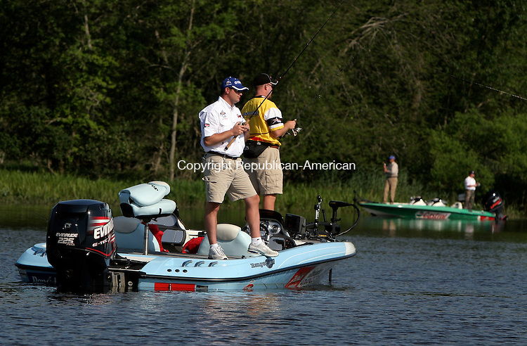 EAST HARTFORD, CT-07July 2006-070706TK09-  A few tournament participants concentrate their casting efforts in a cove on the Salmon River that flows into the Connecticut River above East Haddam. Tom Kabelka Republican-American (bass tournament)
