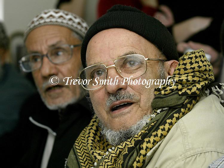 Elderly Yemeni men attend English course at Yemeni Community Centre in Sheffield