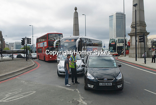 Road traffic accident, road rage, argument car drivers traffic congestion London UK. South side of Lambeth Bridge, Lambeth road roundabout.