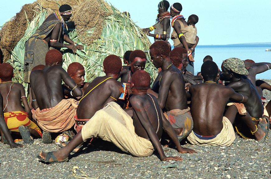 "The El Molo are the smallest ethnic group in Kenya - 25 people in the Seventies, 200 today. For some time now the El Molo have been intermingling with their neighbours the Samburu and Turkana, and nowadays no-one still speaks the language of their forebears. They live on lava rock on the southeast shore of Lake Turkana. Their dwellings resemble ""abandoned nests of ancient prehistoric birds"" (Alberto Moravia), constructed with Dum palm trunk. This tiny population fishes the lake for Nile perch and tilapia; they occasionally hunt crocodiles and hippos."