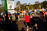 Golf fans make their way towards Gate 6 of the Augusta National Golf Club on the first tournament day of The Masters Golf Tournament in Augusta, Georgia April 8, 2010.