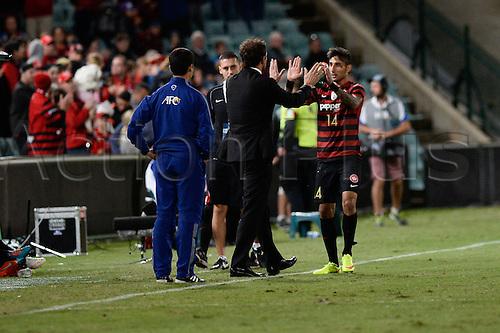 07.04.2015. Sydney, Australia. AFC Champions League. Western Sydney Wanderers v FC Seoul. Wanderers forward Kerem Bulut celebrates his goal with his coach Tony Popovic.