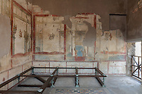 The Triclinium, probably used for lunches, a large room open to the garden, with walls painted on a white background with figures and plants and ornamental borders and floating figures of the seasons, in the Casa dell Efebo, or House of the Ephebus, Pompeii, Italy. This room is decorated in the Fourth Style of Roman wall painting, 60-79 AD, a complex narrative style. This is a large, sumptuously decorated house probably owned by a rich family, and named after the statue of the Ephebus found here. Pompeii is a Roman town which was destroyed and buried under 4-6 m of volcanic ash in the eruption of Mount Vesuvius in 79 AD. Buildings and artefacts were preserved in the ash and have been excavated and restored. Pompeii is listed as a UNESCO World Heritage Site. Picture by Manuel Cohen