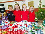 L-R Jago&Padma Brodie with Emily&Abigail O'Dowd from Brandon at their stall Fun Fabrics in which they donate 65% of the profit to the Laura Lynn children hospice at the Brandon Christmas fair in the Halla Le Cheile last Sunday afternoon.