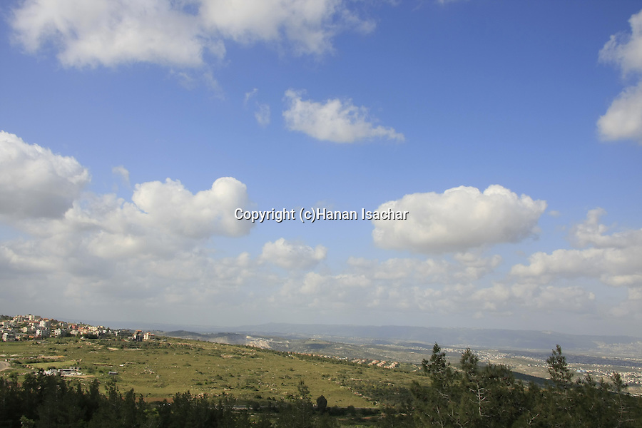 Israel, Lower Galilee, Arab village Kaukab Abu el-Hija (left) a view from Shkhanya forest
