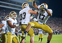 Running back Cam McDaniel (33) celebrates his touchdown with wide receiver James Onwualu (17).