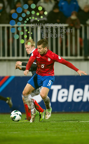Steven Naismith of Scotland challenges for the ball against Matija Nastasic of Serbia during the Fifa World Cup Qualifier between Serbia and Scotland at Stadion Karadorde, Novi Sad, Serbia. 26 March 2013. Picture by Ian Sneddon / Universal News and Sport (Scotland). All pictures must be credited to www.universalnewsandsport.com. (Office) 0844 884 51 22. .