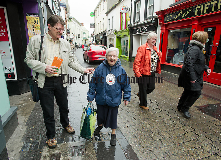 European election candidate Diarmuid O Flynn of the Ballyhea Campaign Group canvassing a voter on O Connell Street, Ennis on Wednesday. Photograph by John Kelly.