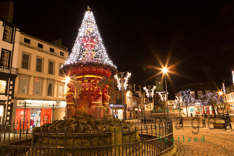 Christmas lights in town centre Queensberry Square Dumfries looking up to Midsteeple