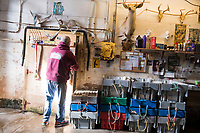 "Mark Barlow, co-owner of Island Seafood, a Maine-based lobster dealer, opens a door to the bait room in Island Seafood's ""bait shop"" where fishermen bring lobsters to sell to the dealer in on Badger's Island in Kittery, Maine, USA, on Wed., Jan. 31, 2018"