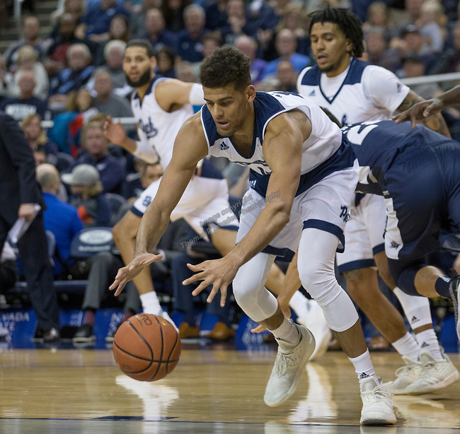 Nevada forward Trey Porter goes after a lose ball against Utah State in the second half of an NCAA college basketball game in Reno, Nev., Wednesday, Jan. 2, 2019. (AP Photo/Tom R. Smedes)
