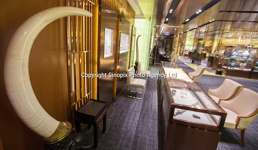 One tusk from a pair of ivory tusks worth HK$8.2 million (GBP648,000.00) is seen on sale in 'Chinese Arts &amp; Crafts', Hong Kong, China, 29 November 2013. <br /> <br /> Photo by Alex Hofford / Sinopix