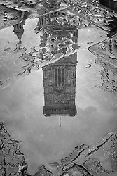 Giotto's Bell Tower reflected in a puddle on the piazza after a brief rainfall, Florence.