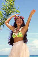 Part hawaiian young woman (wahine) near beach dancing modern hula (auana)
