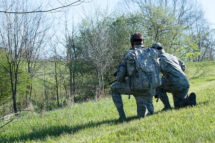 Two Airforce cadets look into the woods fr a possible threat during their mobile exercise on April 16 2016. Photo by Ohio University / Kaitlynn Stone