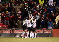 Jake Pace (20) of Maryland celebrates his goal with teammates Suli Dainkeh (22), Patrick Mullins (15), and Tsubasa Endoh (31) during the second round of the NCAA tournament at Ludwig Field in College Park, MD.  Maryland defeated Providence, 3-1.