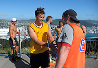 Peter Umaga-Jensen congratulates asistant coach Jason Holland after the Hurricanes Super rugby surf to peak run ride run to Mt Victoria in Wellington, New Zealand on Saturday, 17 December 2016. Photo: Dave Lintott / lintottphoto.co.nz