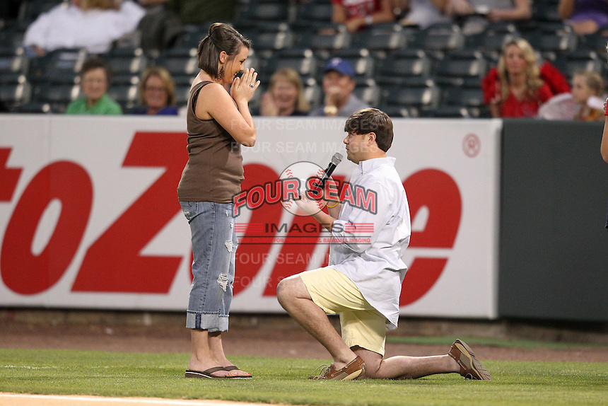 Memphis Redbirds fans marriage proposal during a game versus the Round Rock Express at Autozone Park on April 29, 2011 in Memphis, Tennessee.  Round Rock defeated Memphis by the score of 5-4 in 13 innings.  Photo By Mike Janes/Four Seam Images