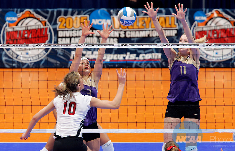 17 DEC 2005:  Courtney Thompson (3) and Darla Myhre (11) of the University of Washington combine for a block against Jordan Larson (10) of the University of Nebraska during the Division I Women's Volleyball Championship held at the Alamodome in San Antonio, TX.   Washington defeated Nebraska 3-0 to win the national title.  Jamie Schwaberow/NCAA Photos