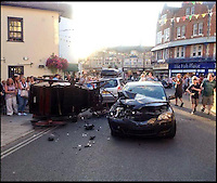 BNPS.co.uk (01202 558833)<br /> Pic: DFRS/BNPS<br /> <br /> ***Please Use Full Byline***<br /> <br /> Holiday makers rushed for cover after a runaway horse and carriage careered through the seaside town and crashed into a car.<br /> <br /> The horse-drawn cart was being driven through the packed streets of Swanage, Dorset, when crowds spooked the horse and it bolted.<br /> <br /> The 20-year-old at the reins of the out-of-control cart was thrown 30ft in the collision with an unsuspecting driver's car.<br /> <br /> Both the horse and the four-wheeled cart were thrown onto their sides, narrowly missing passing bystanders.<br /> <br /> Incredibly the cart driver, the female car driver and the horse all escaped unscathed.<br /> <br /> Emergency services rushed to the scene at Swanage High Street where they treated both drivers for shock.<br /> <br /> It took eight firefighters to right the 110-year-old carriage.<br /> <br /> The shaken horse was recovered by members of the public.