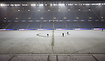 Groundstaff trying to clear the lines of snow at Ibrox Stadium