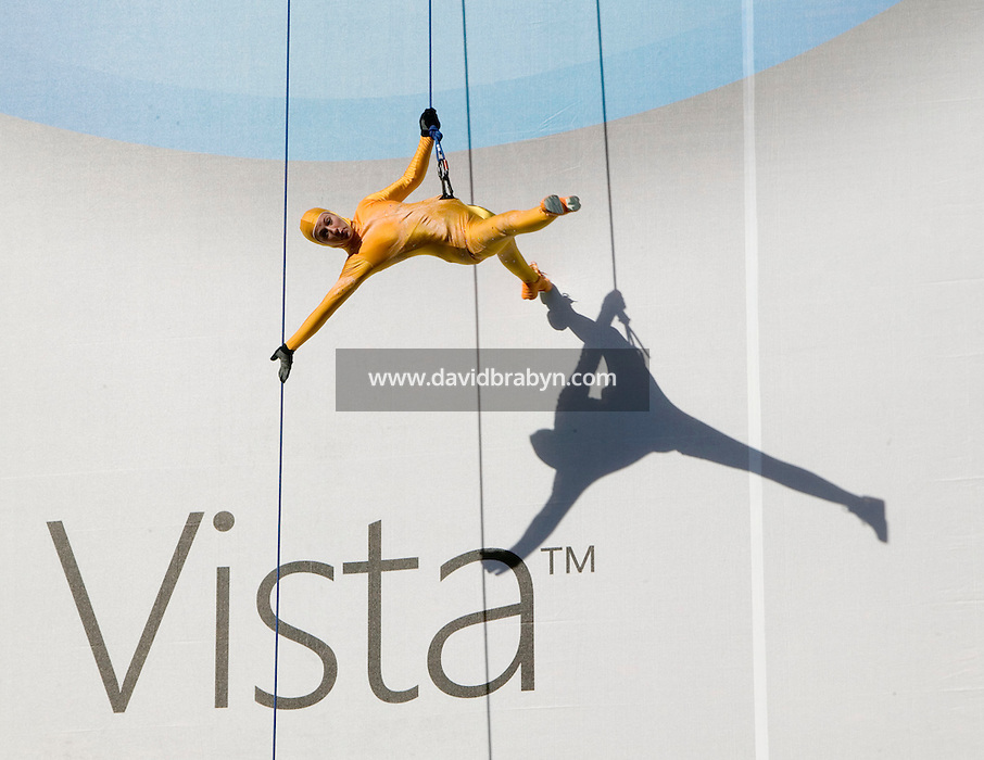 29 January 2007 - New York City, NY - Dancers from the Grounded Aerial Dance Theater perform hanging from ropes against a giant banner fixed to the side of a building in New York City, USA, to mark the launch of Microsoft's new operating system Windows Vista and software suite Office, 29 January 2007.