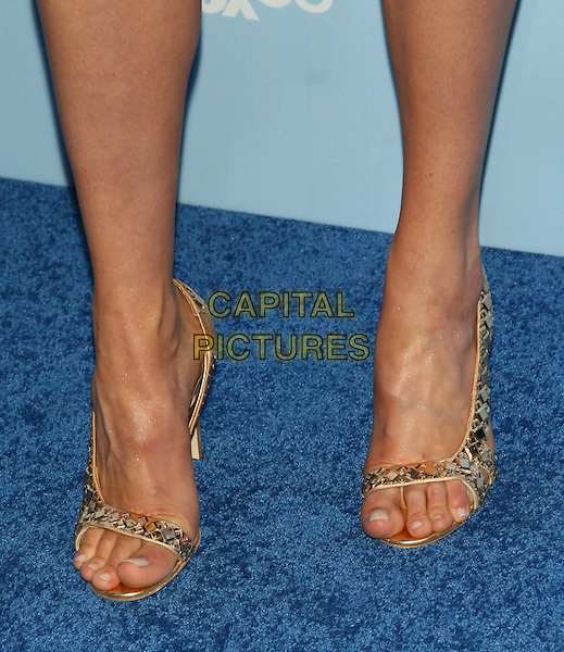 CAT DEELEY'S SHOES.2008 Fox Televison Network Upfront (programming presentation to advertisers) at Wollman Rink in Central Park, New York, NY, USA..May 15th, 2008.gold silver heels toes feet jewel encrusted .CAP/LNC/TOM.©TOM/LNC/Capital Pictures.