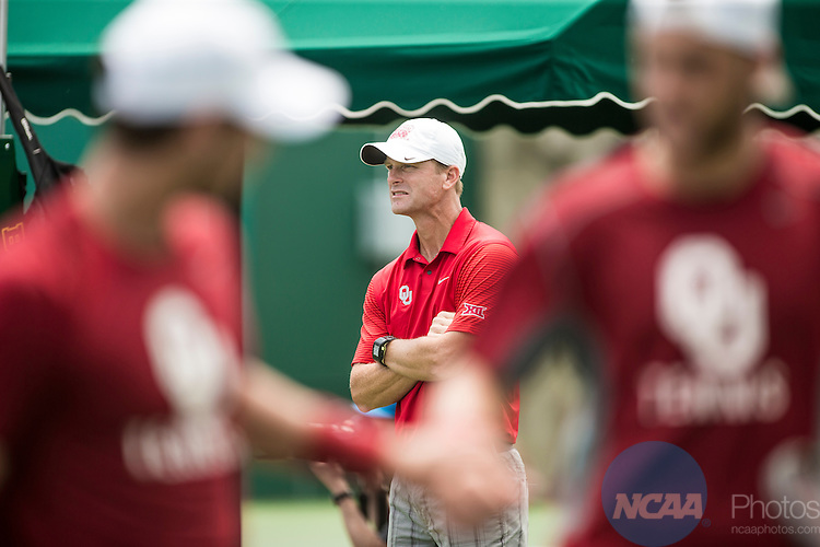 19 MAY 2015:  Oklahoma Head Coach John Roddick looks on during the Division I Men's Tennis Championship is held at the Hurd Tennis Center on the Baylor University campus in Waco, TX.  Virginia defeated Oklahoma 4-1 to win the team national title.  Darren Carroll/NCAA Photos