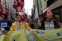 Sachiko Sato of the anti nuclear Fukushima mothers leads a march of anti nuclear power campaigners during a rally by left wing activists and unionists in Tokyo, Japan. Sunday November 3rd  2013