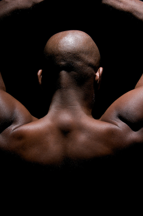 Close up of a worked out back and Biceps of an African American Young.