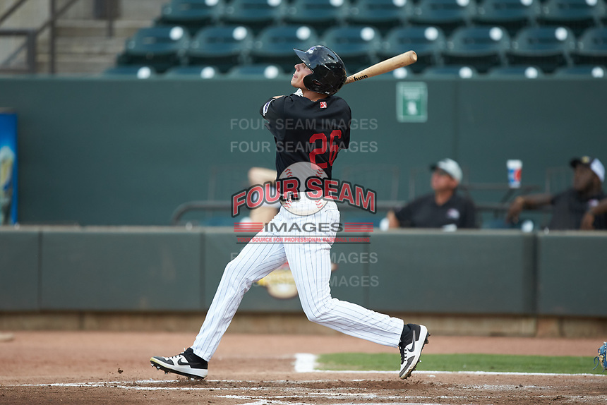 Craig Dedelow (26) of the Winston-Salem Warthogs follows through on his swing against the Wilmington Blue Rocks at BB&T Ballpark on July 17, 2019 in Winston-Salem, North Carolina. The Blue Rocks defeated the Warthogs 4-1. (Brian Westerholt/Four Seam Images)
