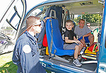 Winsted, CT 091618MK14 Brendon Colt, paramedic, gives a tour of the Life Star to Max Matherson and Carson Hyatt at the Winsted Fire Department safety day at the Tiffany-Gaylord Playground on Rowley Street. Activities included a firefighter challenge, Touch-a-Truck, child safety seat installation and inspections, smoke alarm safety demos. Michael Kabelka / Republican-American