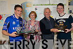 TOP OF THE CLASS: Joan Murphy (Tarbert) and Denis Dennison (Abbeyfeale)  who retired from their teaching posts at St. Itas College in Abbeyfeale on Friday last being presented with gifts from Eoin Joy (School Captain) and Sean Sheahan (Captain of Games). .