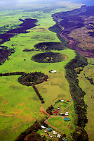 Aerial of the lush green tip of the Big Island of Hawaii known as South Point.