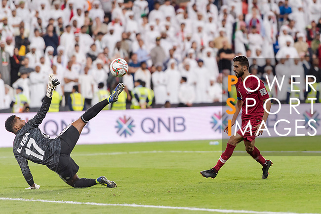 Goalkeeper Khalid Eisa Bilal of United Arab Emirates (L) reaches for the ball after an attempt at goal by Hasan Al Haydos of Qatar (R) during the AFC Asian Cup UAE 2019 Semi Finals match between Qatar (QAT) and United Arab Emirates (UAE) at Mohammed Bin Zaied Stadium  on 29 January 2019 in Abu Dhabi, United Arab Emirates. Photo by Marcio Rodrigo Machado / Power Sport Images