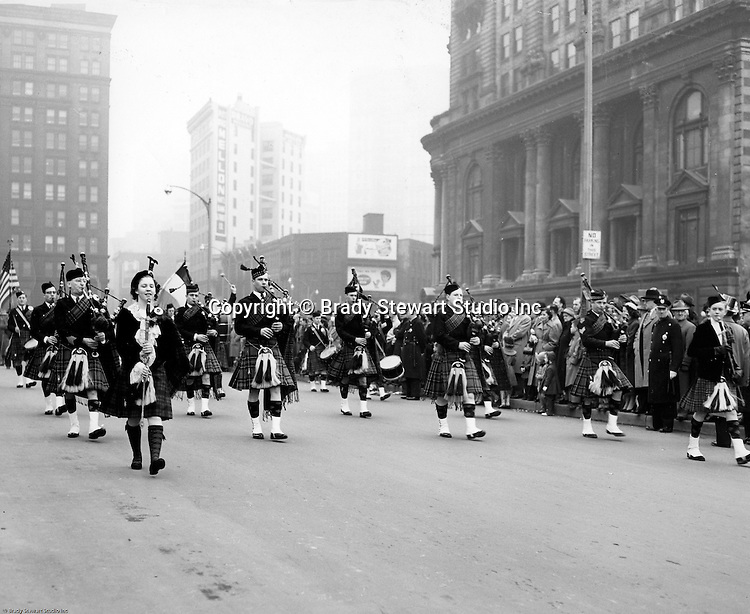 Pittsburgh PA:  View of the Annual Veteran's Day Parade in Pittsburgh - 1957.  Pittsburgher's have always enjoyed a good parade down Fifth Avenue to Liberty Avenue and finish at Water Street.  Diamond Building, 100 Fifth Avenue and the Empire Building are in the background.