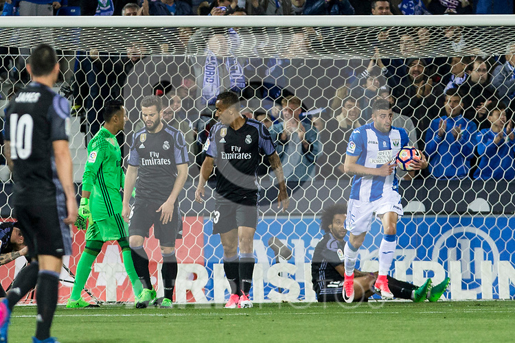 Nacho Fernandez, Danilo Luiz da Silva and Marcelo Vieira reacts and Diego Rico of Club Deportivo Leganes celebrates after scoring a goal during the match of  La Liga between Club Deportivo Leganes and Real Madrid at Butarque Stadium  in Leganes, Spain. April 05, 2017. (ALTERPHOTOS / Rodrigo Jimenez)