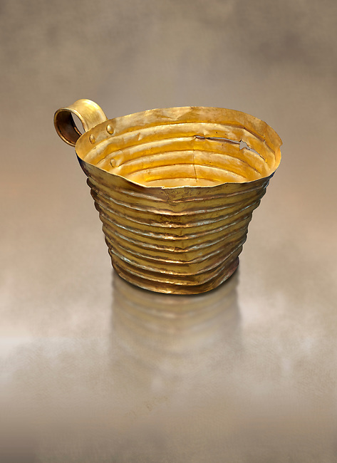 Mycenaean gold cup with horizontal grroves, Grave IV, Grave Circle A, Mycenae, Greece. National Archaeological Museum of Athens. <br /> <br /> An elegant precious gold cup hammered from thick gold to created a simple elegant design. This Mycenaean gold cup demonstrates how advance Mycenaean metalworking was in the 16th century BC. The value of the cup would have been extermely high so must have graced the table of a Mycenaean noble perhaps even a v king.
