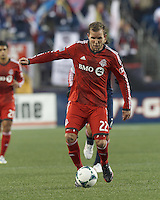 Toronto FC forward Jeremy Brockie (22) brings the ball forward.  In a Major League Soccer (MLS) match, the New England Revolution (blue) defeated Toronto FC (red), 2-0, at Gillette Stadium on May 25, 2013.