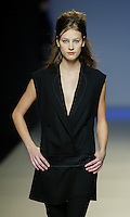 A model presents a creation by Miguel Palacio during the Pasarela Cibeles fashion show 2005, February 16, 2005 in Madrid. Photo by Victor Fraile / studioEAST