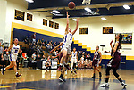 WATERBURY CT. 18 February 2018-021819SV01-#5 Emma Cretella of St. Paul High puts up a shot over Naugatuck High during the NVL semi final at Kennedy High in Waterbury Monday.<br /> Steven Valenti Republican-American