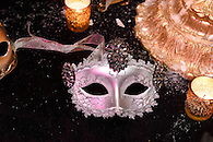 Still life image with mask on a table at a masquerade ball.