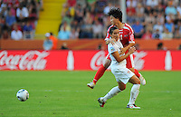 Alex Krieger (l) of Team USA and Ri Ye Gyong of Team North Korea during the FIFA Women's World Cup at the FIFA Stadium in Dresden, Germany on June 28th, 2011.