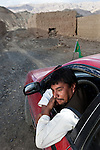 November 2012, Bamiyan, Afghanistan: Local driver Assadullah in his car at Bamiyan home to the empty Buddhas of Bamiyan niches, two 6th century monumental statues of standing buddha carved into the side of a cliff in the Bamyan valley in the Hazarajat region of central Afghanistan. Assadullah traverses the dangerous road to Kabul where insurgents regularly beat , extort and kill Hazara's making the journey.The valley is home to many Hazara's, who have often made up vast numbers of refugees to Australia, having been persecuted and driven from their homes in both Afghanistan as well as from Quetta in Pakistan where a lot of displaced Hazara fled to during the Taliban years. Bamiyan is home to a lot of Hazara who are Shia muslim and as such are looked down upon by the Sunni Pashto tribes that make up the population majority in Afghanistan.   Picture by Graham Crouch/The Australian Magazine.