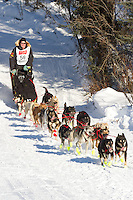 Musher Ed Stielstra on Long Lake at the Re-Start of the 2011 Iditarod Sled Dog Race in Willow, Alaska.