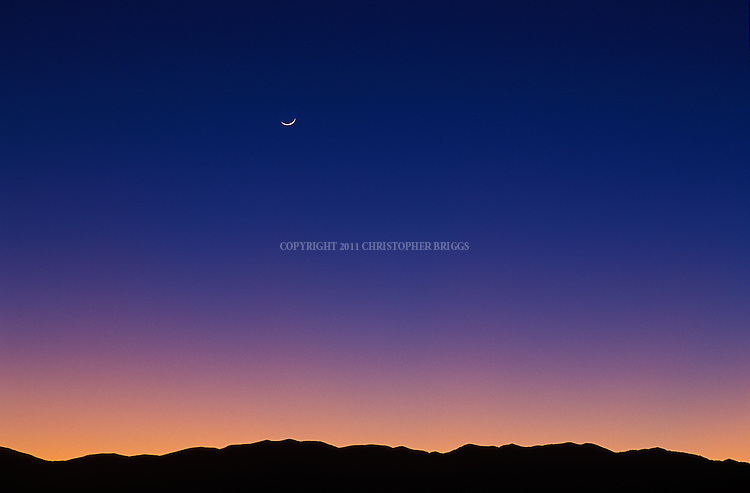 Sunset and moon over the White Mountains, CA.