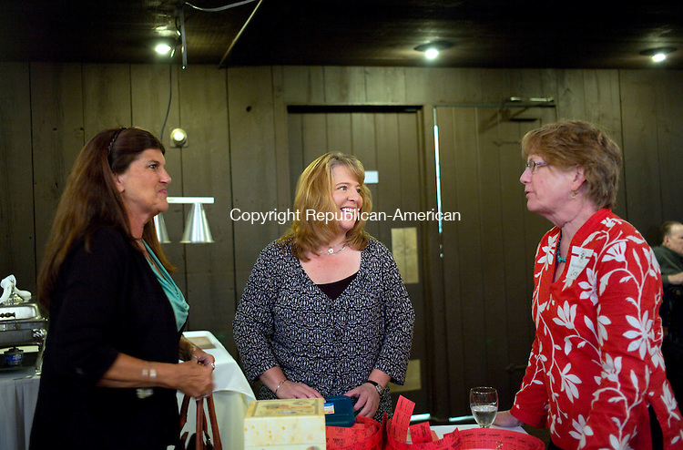 Oxford, CT- 16 October 2015-101615CM05- Judy Umstead, left, animal control officer for the towns of Bethlehem and Woodbury,  Cori Wlasuk, assistant animal control officer for the Town of Oxford and  Cate Mulvey a volunteer with Rose Hope chat during benefit dinner at the Colonial Tavern in Oxford on Friday.  Scot Haney from WFSB-Channel 3 was the Master of Ceremonies for the evening with approximately 200 people attending.  All proceeds will go directly to Rose Hope Animal Refuge is a small non-profit, no kill animal rescue in Waterbury, CT.       Christopher Massa Republican-America4