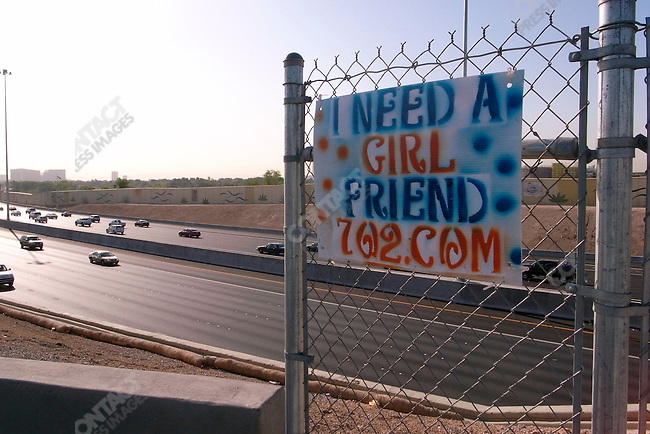 Advertisment for a girl friend over looking a highway, Las Vegas, Nevada, USA, April 10, 2008