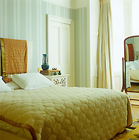 In contrast to the bold use of colour in most of the house, the bedroom is decorated in tranquil eau de nil and cream
