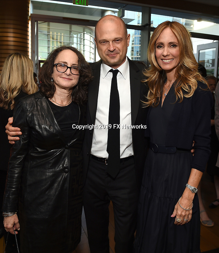 LOS ANGELES - SEPTEMBER 21: (L-R) Nina Jacobson, Brad Simpson, and Dana Walden, Chairman, Disney Television Studios & ABC Entertainment attend the FX Networks & Vanity Fair Pre-Emmy Party at Craft LA on September 21, 2019 in Los Angeles, California. (Photo by Frank Micelotta/FX/PictureGroup)